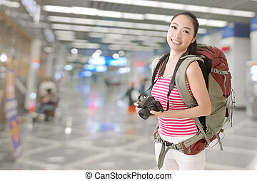 Smiling traveling Asian girl