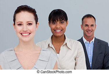 Smiling two businesswomen and a businessman