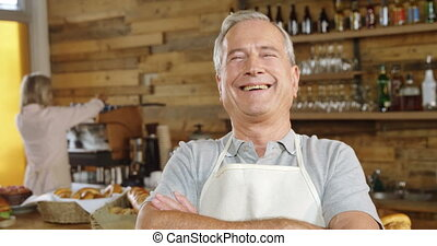 Smiling waiter in cafe 4k - Portrait of smiling waiter in ...