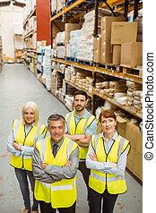 Smiling warehouse team