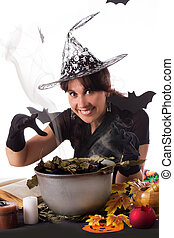 Smiling witch making magic on Halloween