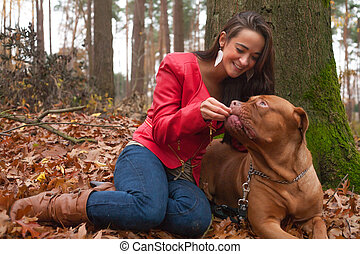 Smiling with my dog - Young woman is having fun with her dog...
