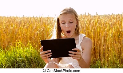 smiling with tablet computer on cereal field - internet,...