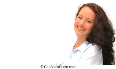 Smiling woman against a white backg