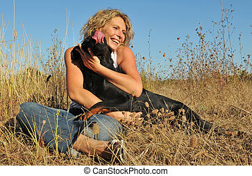 smiling woman and dog