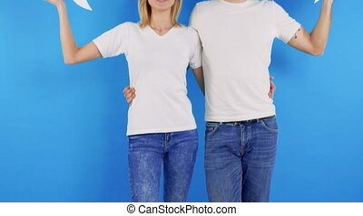 Smiling woman and man holding paper thought bubbles over ...