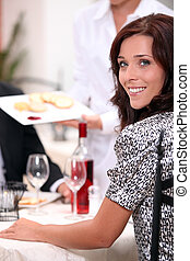 Smiling woman at a dinner
