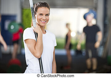 Smiling woman at fitness gym center - Fit young and happy...