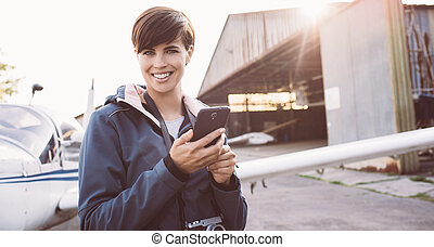 Smiling woman at the aerodrome