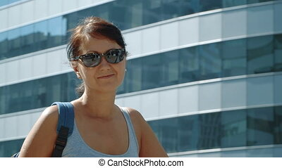 Smiling woman at the skyscraper background