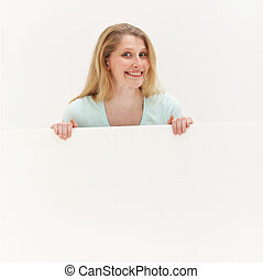 Smiling woman behind blank white board