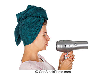 Smiling woman blow drying her hair