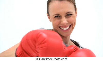 Smiling woman boxing