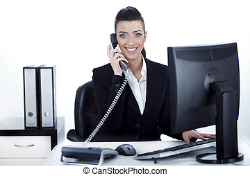 Smiling woman busy over phone