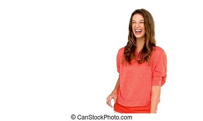 Smiling woman catching a basket ball on white background in...