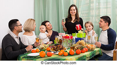 Smiling woman celebrating with family - Smiling woman ...