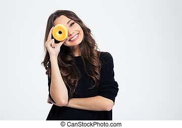 Smiling woman covering her eye with donut