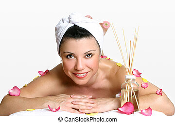 Smiling woman day spa - Smiling woman wearing head turban...