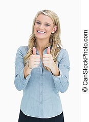 Smiling woman doing thumbs up