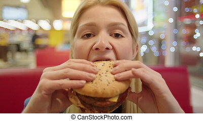 Smiling Woman Eating Burger