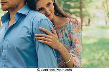 Smiling woman embraces a man