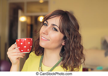 Smiling woman enjoying a cup of tea