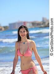 Smiling woman enjoying a summer vacation