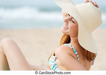 Smiling Woman Enjoying The Sun At The Beach