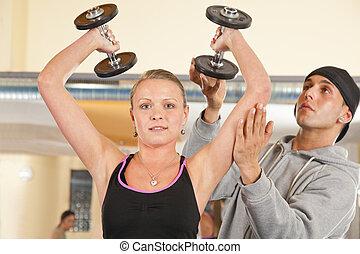 smiling woman exercising in gym