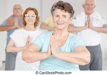 Smiling woman exercising