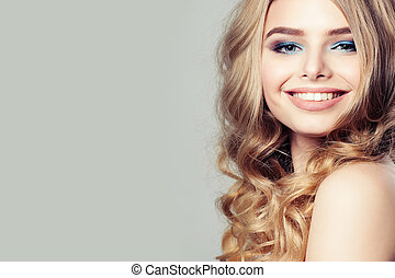 Smiling Woman Fashion Model with Blond Curly Hair on Background