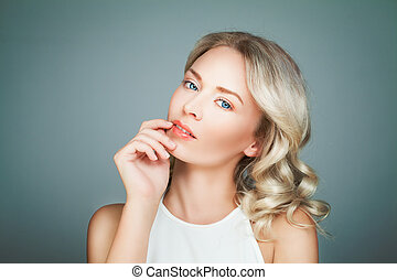 Smiling Woman Fashion Model with Blonde Curly Hair