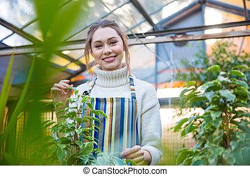 Smiling woman gardener