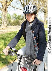 Smiling woman having a bike ride