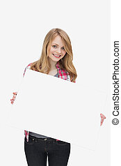 Smiling woman holding a blank board