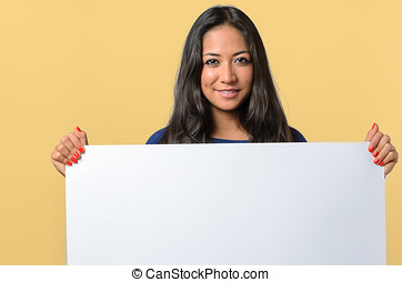 Smiling woman holding a blank white sign