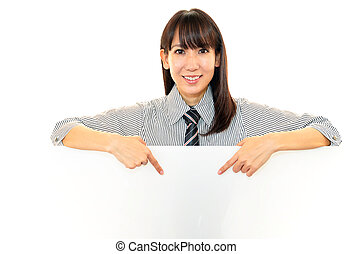 Smiling woman holding a board