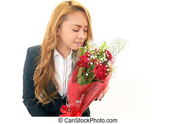 Smiling woman holding a bouquet