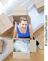 Smiling woman holding a box