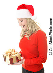 Smiling woman holding a Christmas gift