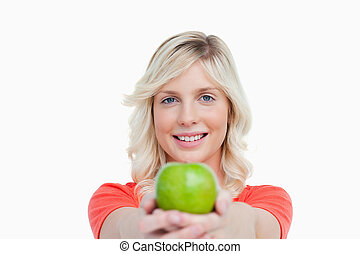 Smiling woman holding a delicious green apple