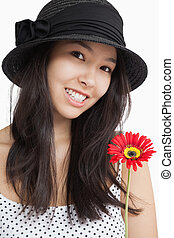 Smiling woman holding a flower