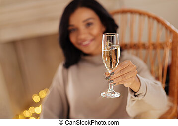 Smiling woman holding a glass of champagne