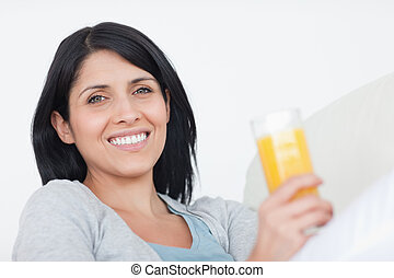 Smiling woman holding a glass of juice