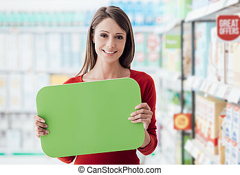 Smiling woman holding a sign