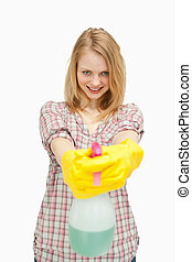 Smiling woman holding a spray bottle
