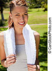Smiling woman holding a towel