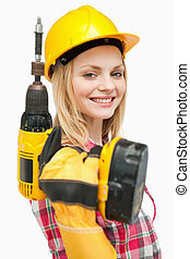 Smiling woman holding an electric screwdriver