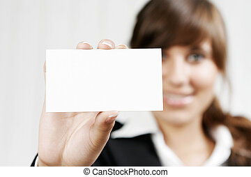 Smiling woman holding an empty card