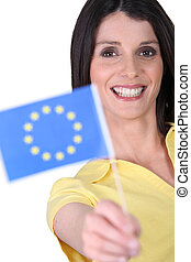 Smiling woman holding an EU flag